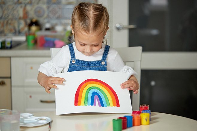 Young girl has painted a rainbow