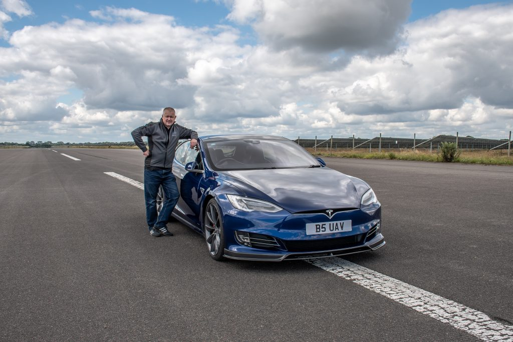 James posing with his new Tesla